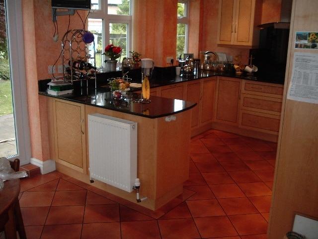 Birds Eye Maple Kitchen With Granite Tops
